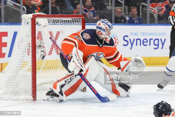 Edmonton Oilers Goalie Anthony Stolarz moves to the left to stop a puck in the second period during the Edmonton Oilers game versus the Toronto Maple...