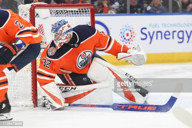 Edmonton Oilers Goalie Anthony Stolarz stops a pass out front in the second period during the Edmonton Oilers game versus the Toronto Maple Leafs on...
