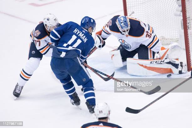 Edmonton Oilers Goalie Anthony Stolarz stops a shot by Toronto Maple Leafs Left Wing Zach Hyman during the second period of the NHL regular season...