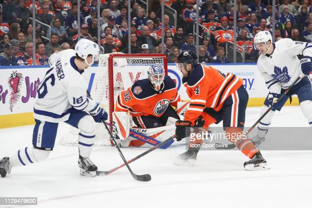 Edmonton Oilers Goalie Anthony Stolarz watches the play as Toronto Maple Leafs Winger Mitch Marner passes the puck in the second period during the...