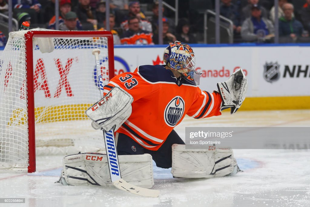 Edmonton Oilers Goalie Cam Talbot (33) makes a glove save during the Edmonton Oilers versus the Calgary Flames at Rogers Place on February 20, 2018 in Edmonton, Alberta.