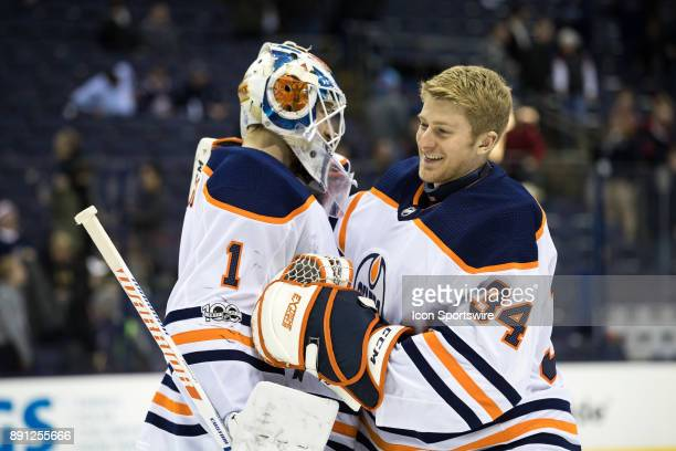 Edmonton Oilers goalie Laurent Brossoit and Edmonton Oilers goalie Nick Ellis celebrate after a game between the Columbus Blue Jackets and the...