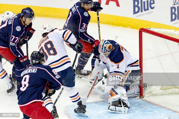 Edmonton Oilers goalie Laurent Brossoit blocks a shot from Columbus Blue Jackets right wing Josh Anderson during a game between the Columbus Blue...