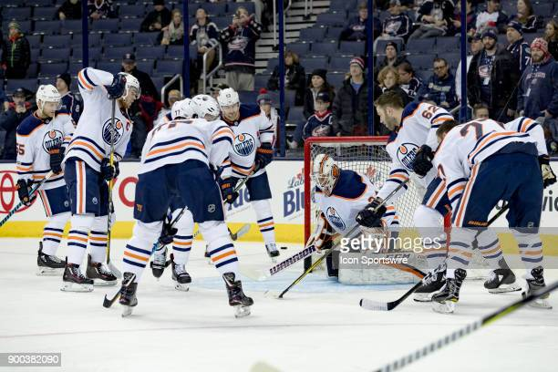 Edmonton Oilers goalie Nick Ellis warms up with the entire team before a game between the Columbus Blue Jackets and the Edmonton Oilers on December...