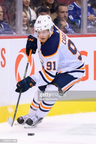 Edmonton Oilers left wing Drake Caggiula skates with the puck during their NHL preseason game against the Vancouver Canucks at Rogers Arena on...