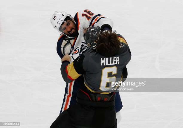 Edmonton Oilers left wing Jujhar Khaira punches Vegas Golden Knights defenseman Colin Miller during the third period of a regular season NHL game...
