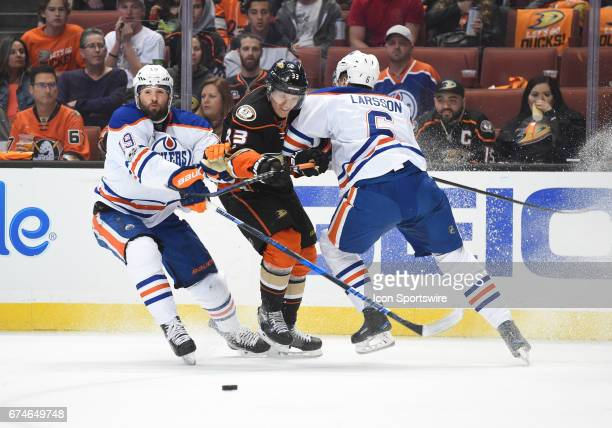 Edmonton Oilers Left Wing Patrick Maroon and Edmonton Oilers Defenceman Adam Larsson sandwich check Anaheim Ducks Right Wing Jakob Silfverberg during...