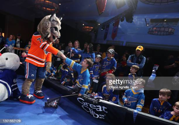 Edmonton Oilers mascot Hunter greets fans as the Atlantic and Pacific division mascots take part in a game of musical chairs during the NHL Mascot...