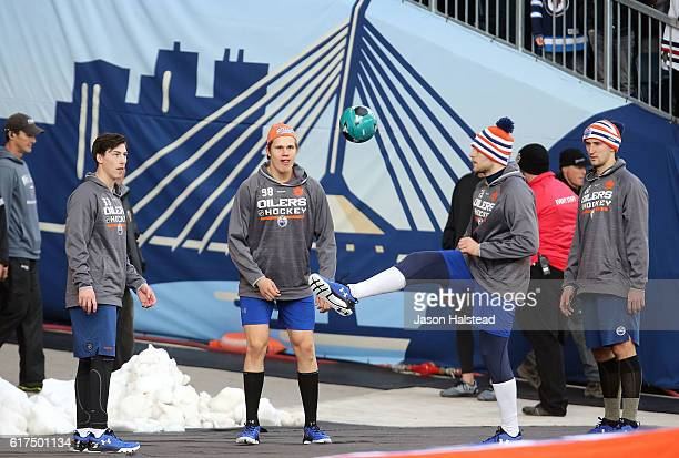 Edmonton Oilers players Ryan NugentHopkins Jesse Puljujarvi Dillon Simpson and Anton Slepyshev warm up with a soccer ball before taking on the...