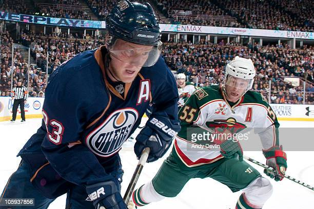 Edmonton Oilers right wing Ales Hemsky carries the puck in the corner under watch from Minnesota Wild defenseman Nick Schultz at Rexall Place on...