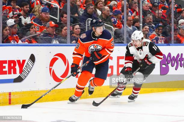 Edmonton Oilers Right Wing Alex Chiasson protects the puck fro Arizona Coyotes Center Jordan Weal in the third period during the Edmonton Oilers game...