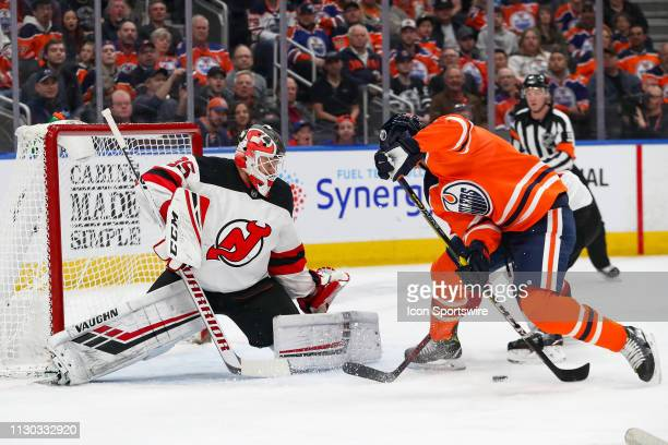 Edmonton Oilers Right Wing Alex Chiasson tries to shovel the puck past New Jersey Devils Goalie Cory Schneider in the first period during the...