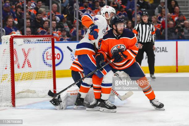 Edmonton Oilers Right Wing Josh Currie battles in front of the net in the second period during the Edmonton Oilers game versus the New York Islanders...