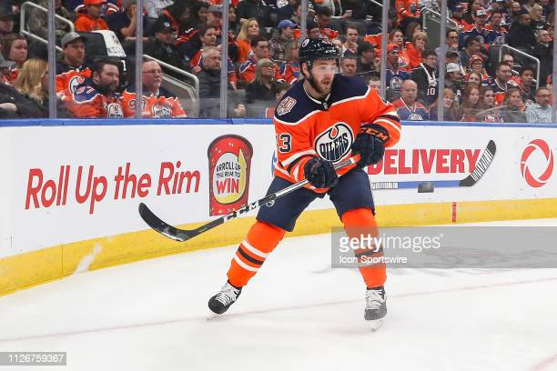 Edmonton Oilers Right Wing Josh Currie passes the puck in the first period during the Edmonton Oilers game versus the New York Islanders on February...