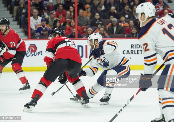 Edmonton Oilers Right Wing Josh Currie shoots the puck at goal as Ottawa Senators Defenceman Dylan Demelo attempts to defend during the first period...