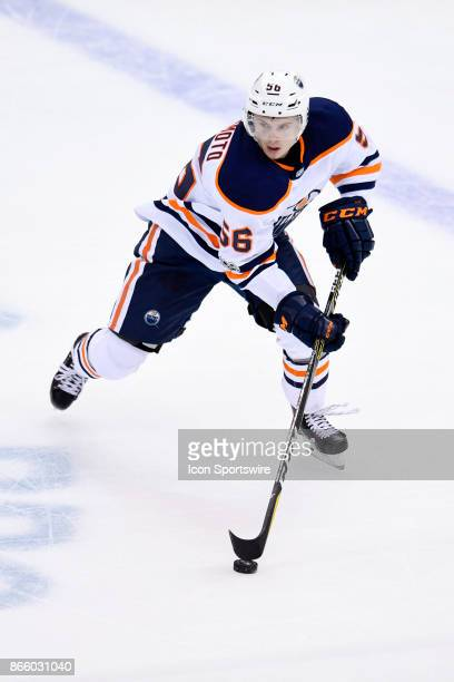 Edmonton Oilers Right Wing Kailer Yamamoto skates with the puck during the third period in the NHL game between the Pittsburgh Penguins and the...