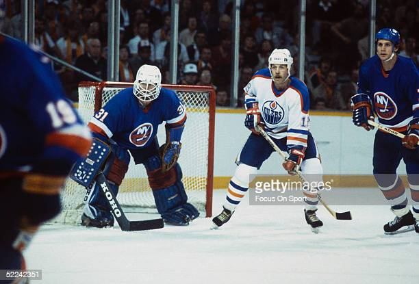 Edmonton Oilers' Right Wing Willy Lindstrom waits in front of the New York Islanders' net as Billy Smith tends goal during the 1980 Stanley Cup...