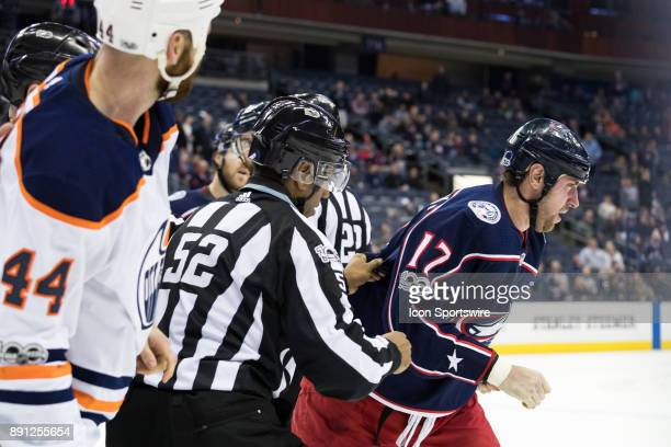 Edmonton Oilers right wing Zack Kassian and Columbus Blue Jackets center Brandon Dubinsky are broken up after a fight as Dubinsky's nose bleeds...