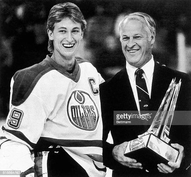Edmonton Oilers team captain Wayne Gretzky is presented with the Emery Edge award by former NHL great Gordie Howe prior to a hockey game between the...