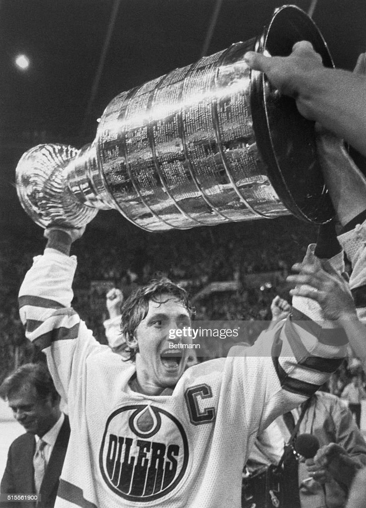 Edmonton Oilers team captain Wayne Gretzky lifts the Stanley Cup high over his head after the Oilers beat the New York Islanders, 5-2, to win the 1984 Stanley Cup series.