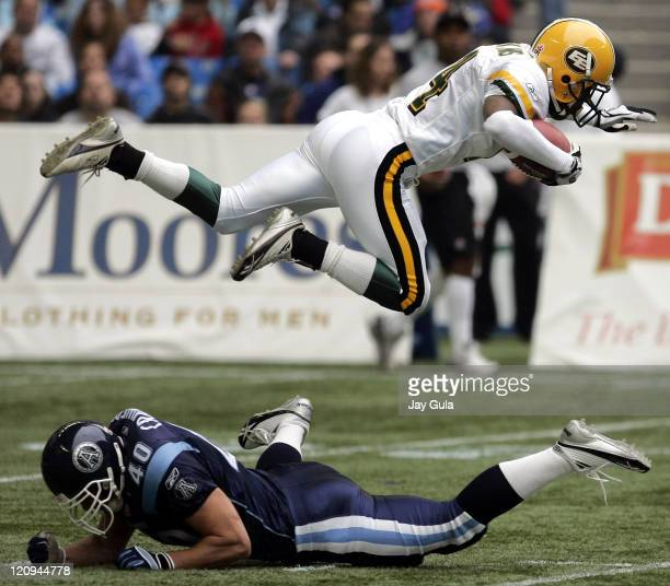 Edmonton WR Tony Tompkins goes airborne after being upended by Toronto's Bryan Crawford during a punt return in CFL action at Rogers Centre in...