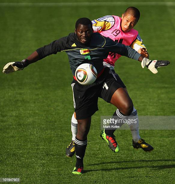 Edmore Sibanda of Zimbabwe and Takayuki Morimoto of Japan compete for the ball during a practice match between Japan and Zimbabwe at Outeniqua...