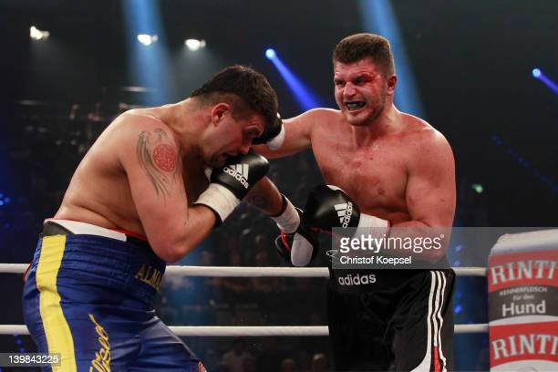 Edmund Gerber of Germany punches Oleksiy Mazikin of Ukraine during the Heavyweight fight between Oleksiy Mazikin of Syria and Edmund Gerber of...
