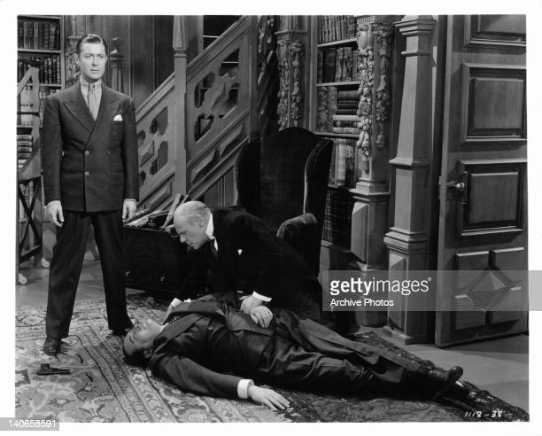 Edmund Gwenn stands over the body of Edwerd Arnold in a scene from the film 'The Earl Of Chicago' 1939