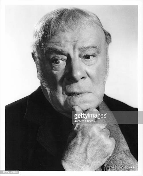 Edmund Gwenn with hand to chin in a scene from the film 'It's A Dog's Life' 1955