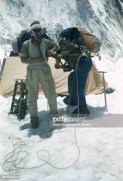 Edmund Hillary and Tenzing Norgay preparing for final assault at Camp IV The second assault party Edmund Hillary checks Tenzing Norgay's equipment at...