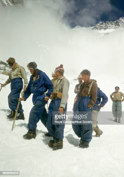 Edmund Hillary roped to Tenzing Norgay returning to Camp IV after their successful ascent of Everest surrounded by other team members Nepal 30th May...