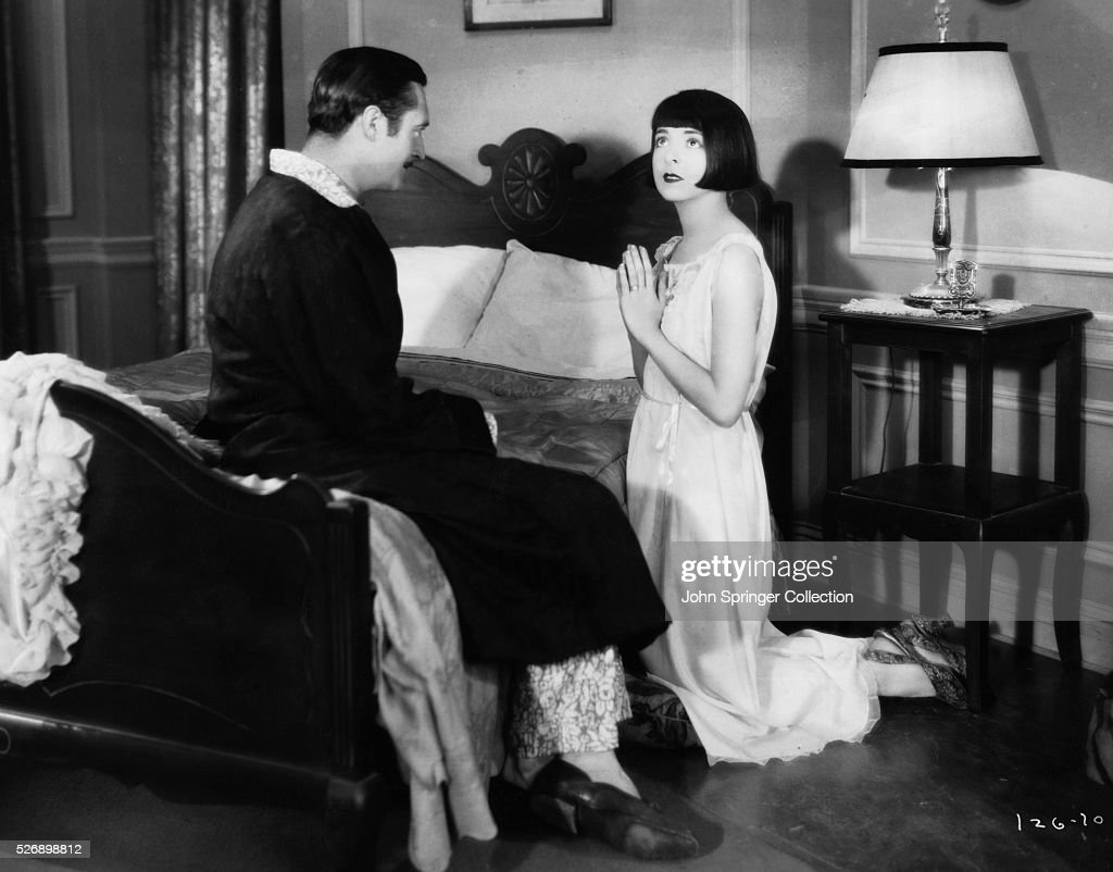 Edmund Lowe as Babe Stewart and Colleen Moore as Mary Randall in the 1928 silent film Happiness Ahead.