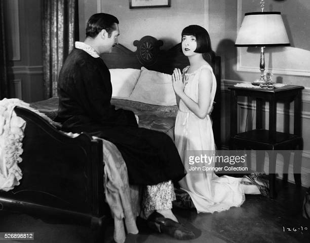Edmund Lowe as Babe Stewart and Colleen Moore as Mary Randall in the 1928 silent film Happiness Ahead