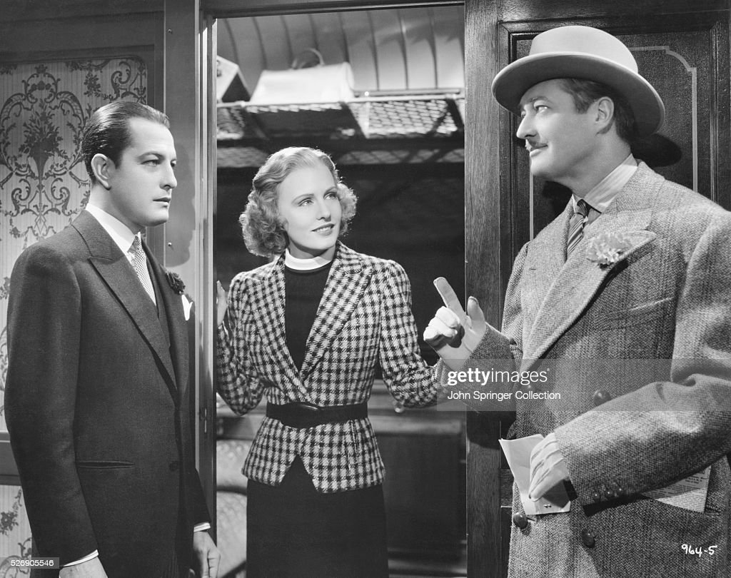 Edmund Lowe (right) as Kenneth Stevens and Madge Evans as Patricia Booth in the 1937 film Espionage.