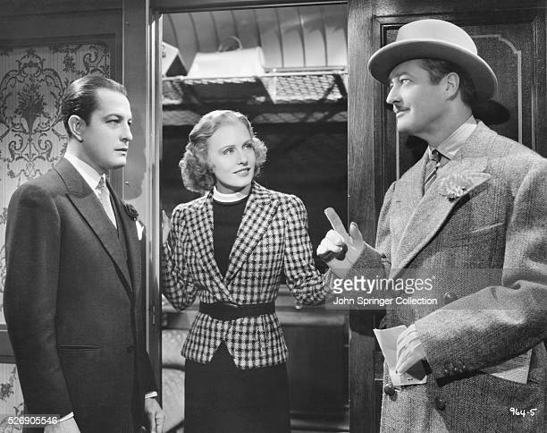 Edmund Lowe as Kenneth Stevens and Madge Evans as Patricia Booth in the 1937 film Espionage