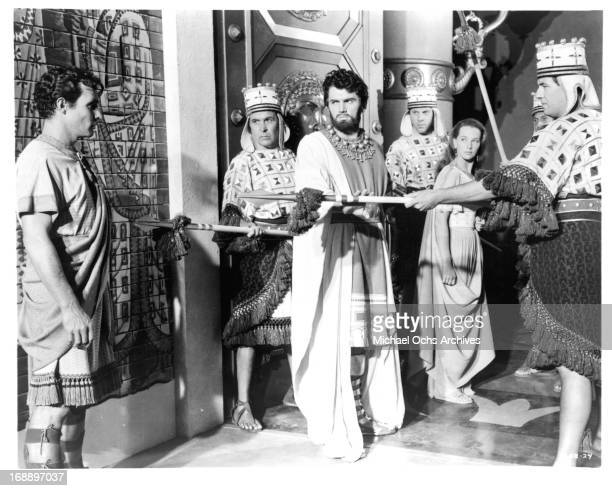 Edmund Purdom and Audrey Dalton are guarded in a scene from the film 'The Prodigal' 1955