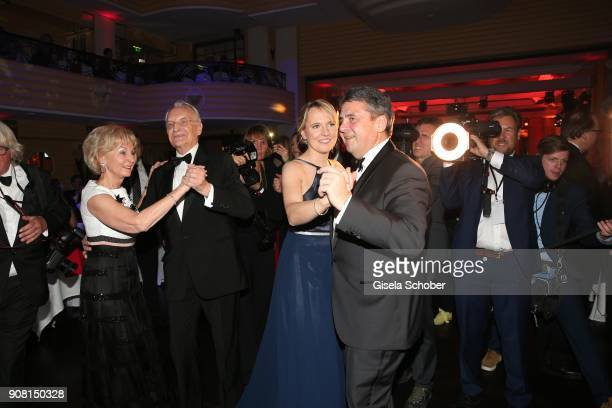 Edmund Stoiber and his wife Karin Stoiber and Sigmar Gabriel and his wife Anke Stadler dance during the German Film Ball 2018 at Hotel Bayerischer...