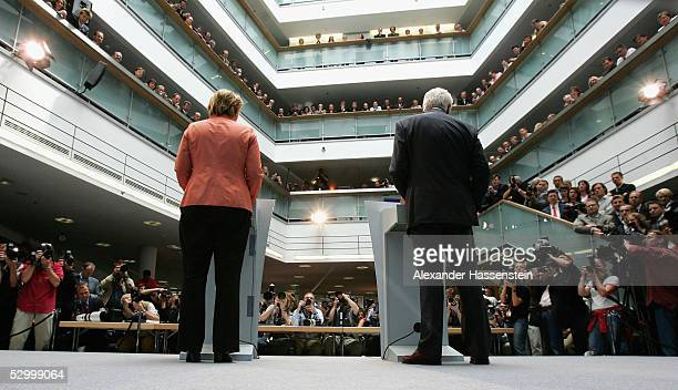 Edmund Stoiber Bavarian State Governor alongside Angela Merkel as she announces her plans as the leader of the Christian Democrats Union on May 30...