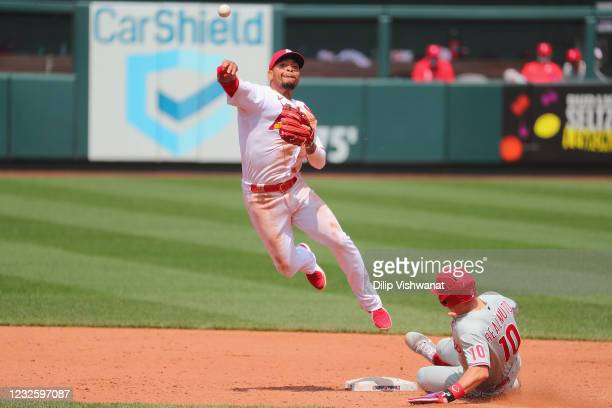 Edmundo Sosa of the St. Louis Cardinals attempts to turn a double play over J.T. Realmuto of the Philadelphia Phillies in the sixth inning at Busch...