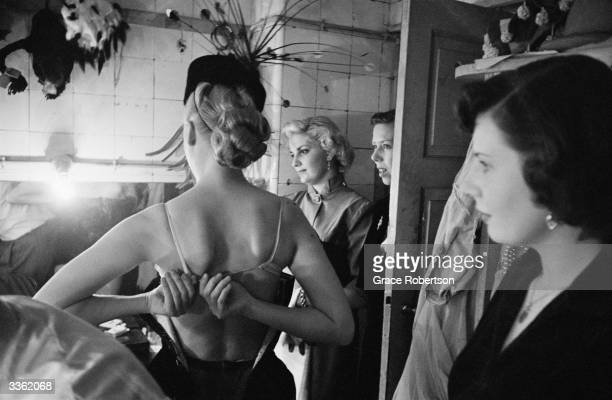 Edna and June members of a Bluebell Girls dance troupe visit another Bluebell troupe in the dressing rooms of the Lido club in the ChampsElysees...