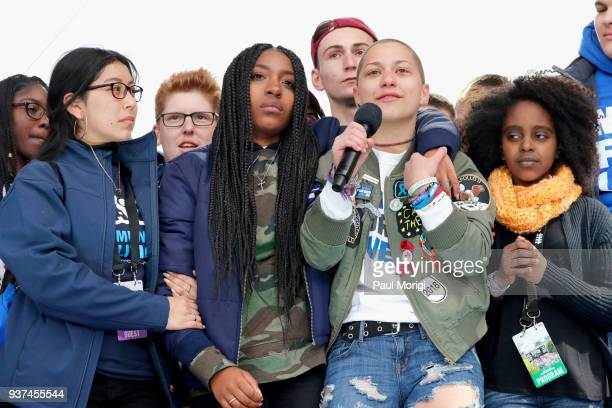 Edna Chavez Emma Gonzalez and Noami Wadler pose onstage with students at March For Our Lives on March 24 2018 in Washington DC