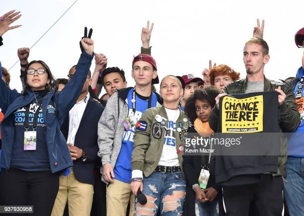 Edna Chavez Zion Kelly Emma Gonzalez Naomi Wadler and Sam Zeif pose onstage at March For Our Lives on March 24 2018 in Washington DC