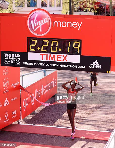 Edna Kiplagat crosses the finish line to win the women's elite race at the Virgin London Marathon on April 13, 2014 in London, England.