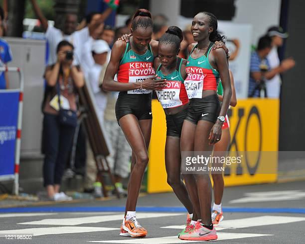Edna Kiplagat of Kenya celebrates after winning the women's marathon event ahead of compatriots Priscah Jeptoo and Sharon Cherop at the International...