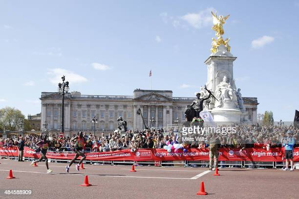 Edna Kiplagat of Kenya leads Florence Kiplagat of Kenya as they pass Buckingham Palace during the Virgin London Marathon on April 13 2014 in London...