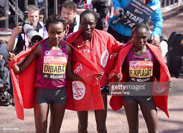 Edna Kiplagat poses with Tirunesh Dibaba and Florence Kiplagat after winning the women's elite race at the Virgin London Marathon on April 13, 2014...