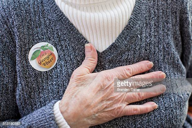 Edna Martinez wears a I'm a Georgia Voter sticker after casting her ballot at Taylorsville Town Hall on Super Tuesday March 1 in Taylorsville Georgia...