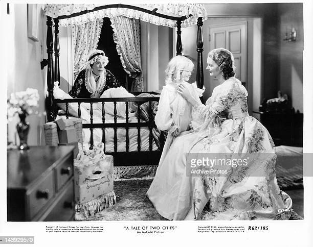 Edna May Oliver watches Elizabeth Allan as she is with child in a scene from the film 'A Tale Of Two Cities' 1935