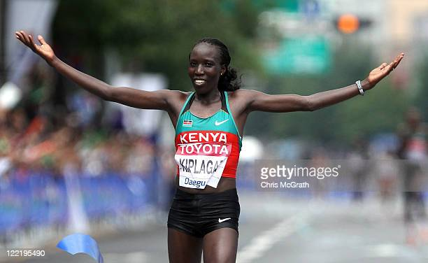 Edna Ngeringwony Kiplagat of Kenya celebrates winning the women's marathon during day one of 13th IAAF World Athletics Championships at the Daegu...