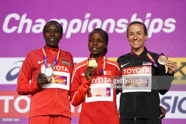 Edna Ngeringwony Kiplagat of Kenya poses with the silver medal, Rose Chelimo of Bahrain poses with the gold medal and Amy Cragg of the United States...